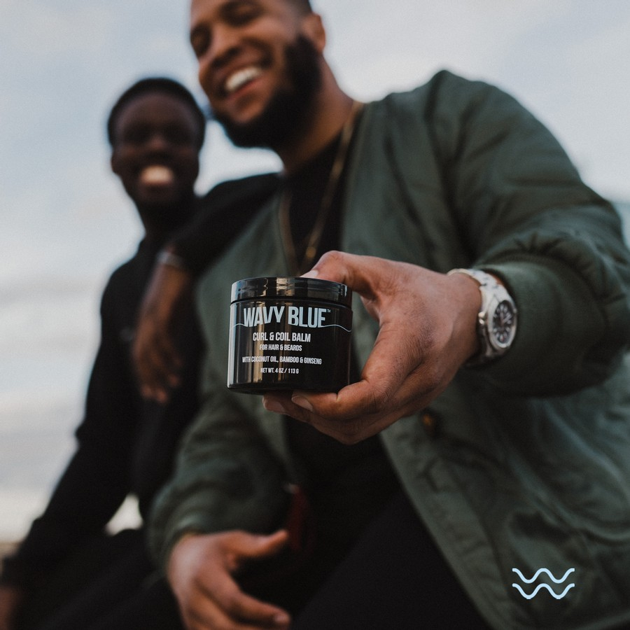 Black-owned founders holding Wavy Blue jar